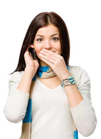 hand on mouth: Teen talking on phone and covering her mouth with hand , isolated on white