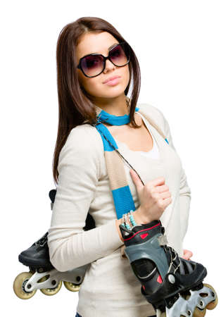 Half-length portrait of teenager handing roller skates and wearing colored scarf and sunglasses, isolated on white photo