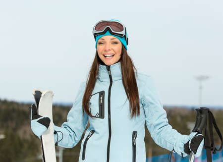 Half-length portrait of female alps skier. Concept of winter sports and cute entertainment photo