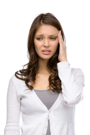 indisposition: Half-length portrait of girl touching her head, isolated on white. Concept of headache and high temperature