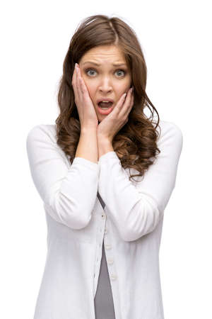 Half-length portrait of shocked woman putting hands on head, isolated on white