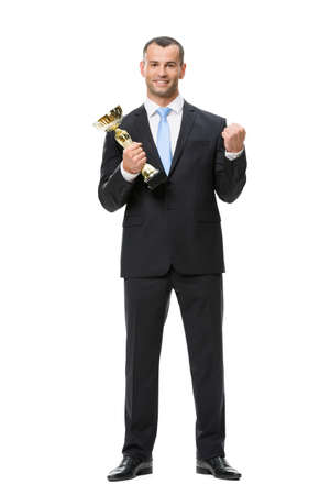 Full-length portrait of business man with golden cup, isolated on white. Concept of leadership and success photo