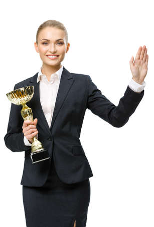 Half-length portrait of businesswoman keeping golden cup and waving her hand, isolated on white. Concept of victory and success photo