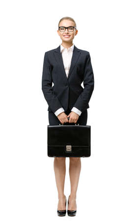 Full-length portrait of business woman handing suitcase, isolated on white. Concept of leadership and success photo