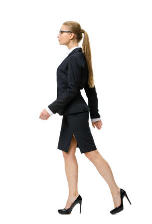 Profile of walking businesswoman, isolated on white. Concept of leadership and success photo