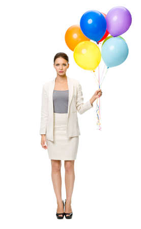 Full-length portrait of businesswoman keeping colorful balloons, isolated. Concept of leadership and success photo