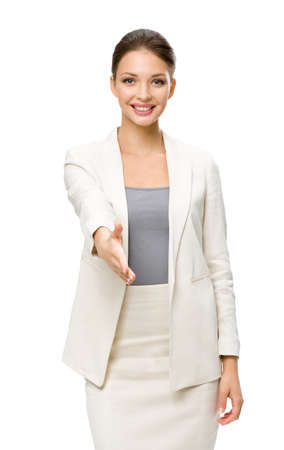 Half-length portrait of businesswoman handshake gesturing, isolated on white. Concept of leadership and success photo