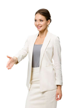 Half-length portrait of business woman handshake gesturing, isolated on white. Concept of leadership and success photo
