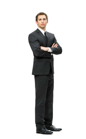 white body suit: Full-length portrait of business man with hands crossed, isolated on white background. Concept of leadership and success