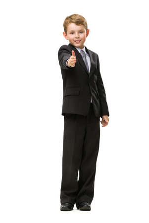 Full-length portrait of little thumbing up businessman, isolated on white. Concept of leadership and success photo