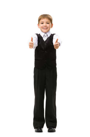 Full-length portrait of thumbing up little manager, isolated on white. Concept of leadership and success photo