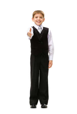 Full-length portrait of thumbing up little businessman, isolated on white. Concept of leadership and success photo