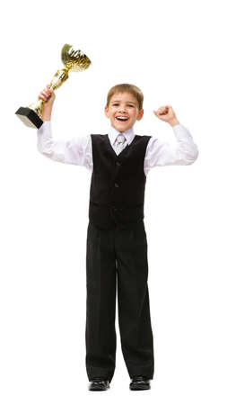 Full-length portrait of little businessman with gold cup, isolated on white. Concept of leadership and success photo
