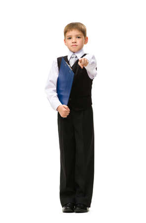 Full-length portrait of little businessman keeping folder and pointing hand gesturing, isolated on white. Concept of leadership and success photo