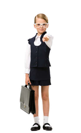 Full-length portrait of little businesswoman handing case and pointing hand gesturing, isolated on white. Concept of leadership and success photo