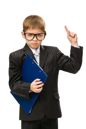 Half-length portrait of little businessman wearing glasses and keeping folder, isolated on white. Concept of leadership and success photo