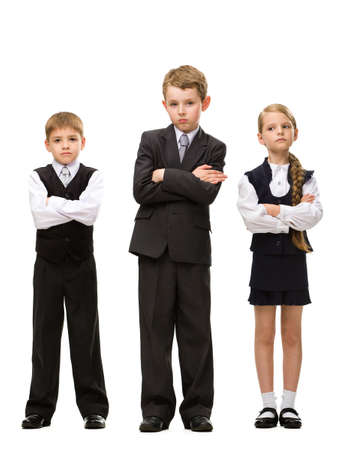 Full-length portrait of little children with hands crossed, isolated on white. Concept of teamwork and cooperation photo