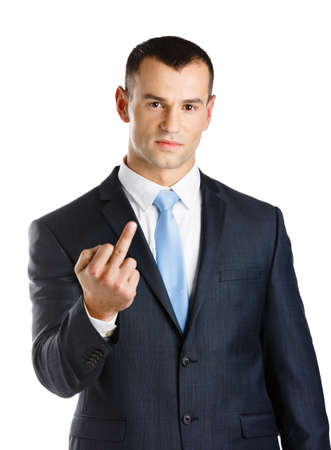 unhappy worker: Businessman showing obscene gesture, isolated on white