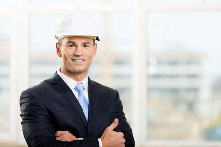architecting: Portrait of engineer in hard hat with his arms crossed
