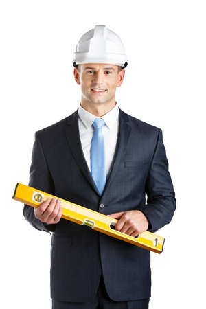 elevation meter: Engineer in hard hat keeps level, isolated on white Stock Photo
