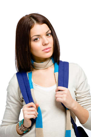 Half-length portrait of teenager wearing blue knapsack and colored scarf, isolated on white photo
