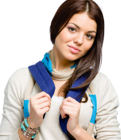 Teenager wearing blue rucksack and colored scarf, isolated on white photo