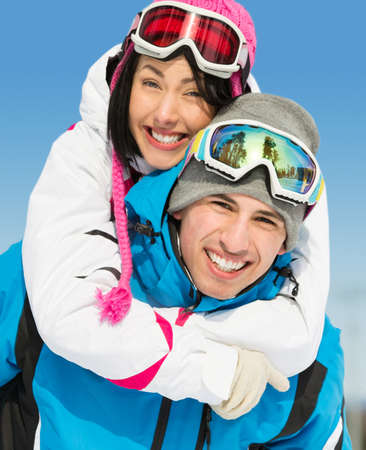 Portrait of happy couple of downhill skiers have fun. Concept of winter sports and cute vacations photo