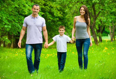 Full-length portrait of happy family of three. Concept of happy family relations and carefree leisure time photo