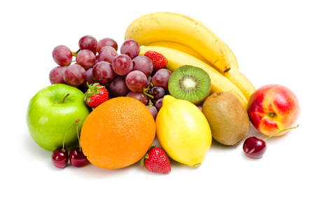 Close up of heap of fruit, isolated on white. Concept of healthy eating and dieting lifestyle photo
