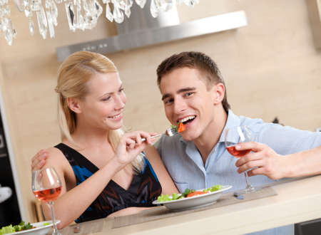 free plate: Married couple has romantic supper in the kitchen