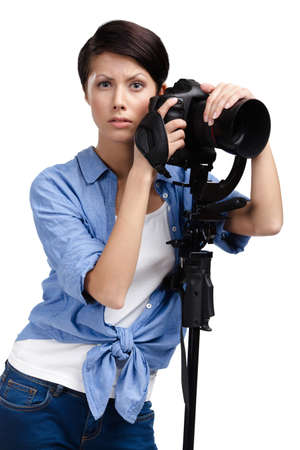 Girl takes snaps holding photographic camera, isolated on white Stock Photo - 24479977