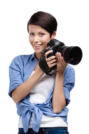 Woman takes images holding photographic camera, isolated on white Stock Photo - 24479981