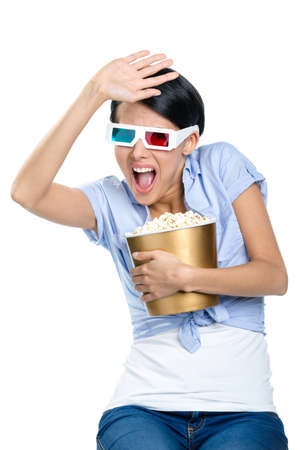 bowl of popcorn: Spectator watching 3D film in glasses with bowl full of popcorn, isolated on white Stock Photo