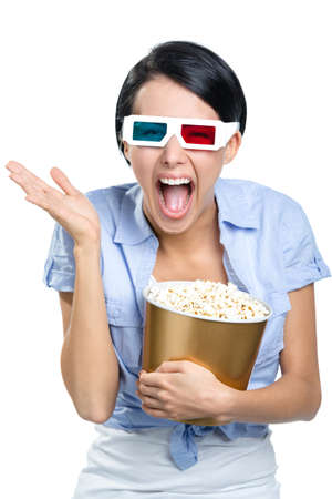 bowl of popcorn: Girl watching 3D film in spectacles with bowl full of popcorn, isolated on white