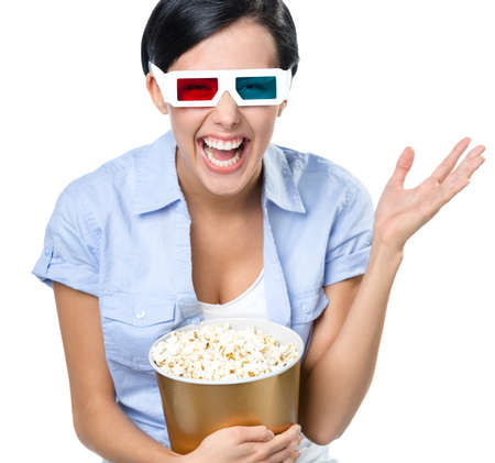 bowl of popcorn: Viewer watching 3D cinema in glasses with bowl full of popcorn, isolated on white