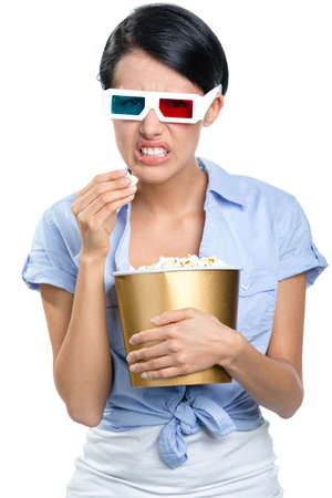 Girl watching 3D cinema in spectacles with bowl full of popcorn, isolated on white photo