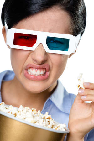 Headshot of the girl in 3D glasses eating popcorn and watching the cinema, isolated on white photo