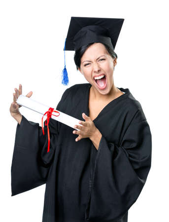 Graduating student in academic black gown and square cap with the diploma, isolated on white photo