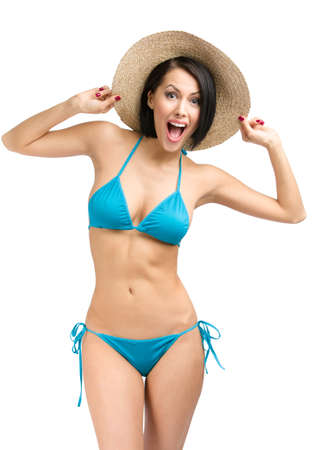 Portrait of woman wearing bikini and hat, isolated on white. Concept of summer holidays and traveling photo