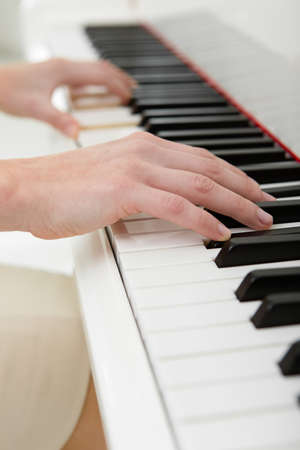 Close up of hands playing piano. Concept of music and leisure photo