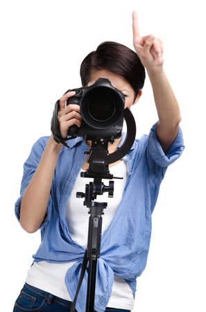 Girl takes pictures holding photographic camera, isolated on white photo