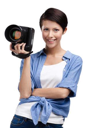 Lady takes images holding photographic camera, isolated on white Stock Photo - 24480515