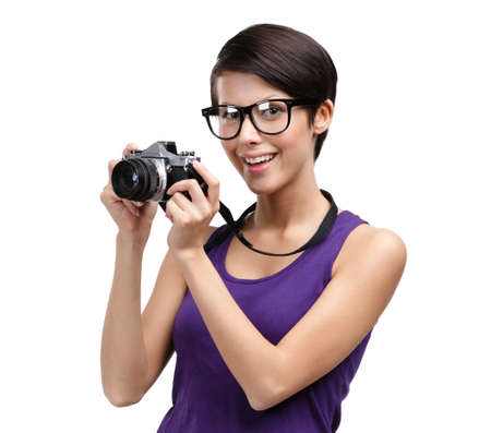 Girl in spectacles hands retro photographic camera, isolated on white Stock Photo - 24480516