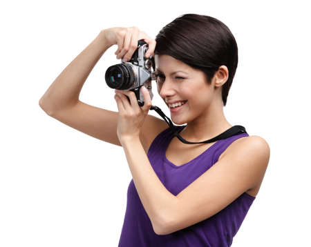Woman in spectacles hands retro photographic camera, isolated on white photo