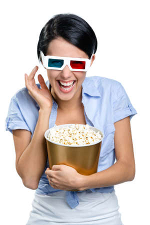Girl watching 3D movie in spectacles with bowl full of popcorn, isolated on white photo
