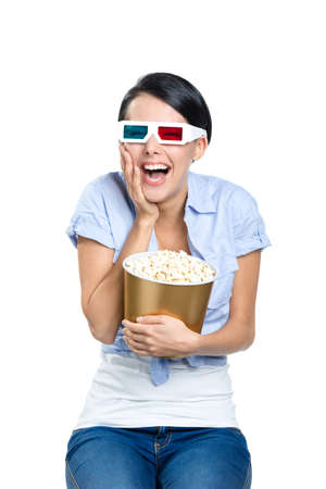 Viewer watching 3D film in spectacles with bowl full of popcorn, isolated on white
