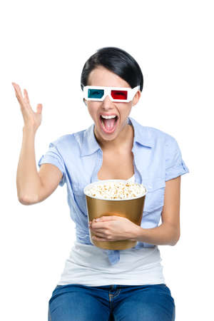 bowl of popcorn: Girl watching 3D cinema in glasses with bowl full of popcorn, isolated on white