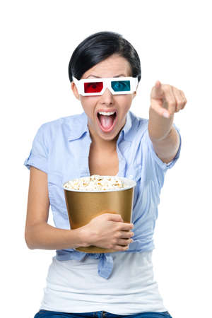 Spectator watching 3D movie in glasses with bowl full of popcorn, isolated on white photo