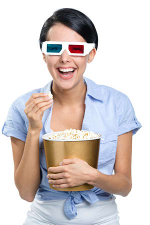 bowl of popcorn: Girl watching 3D movie in glasses with bowl full of popcorn, isolated on white