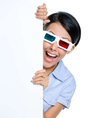 Viewer in 3D spectacles peeps out from behind the copyspace, isolated on white photo